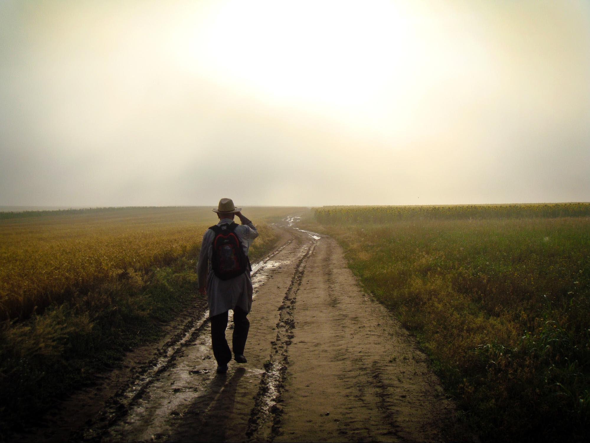 Man walks down dirt road
