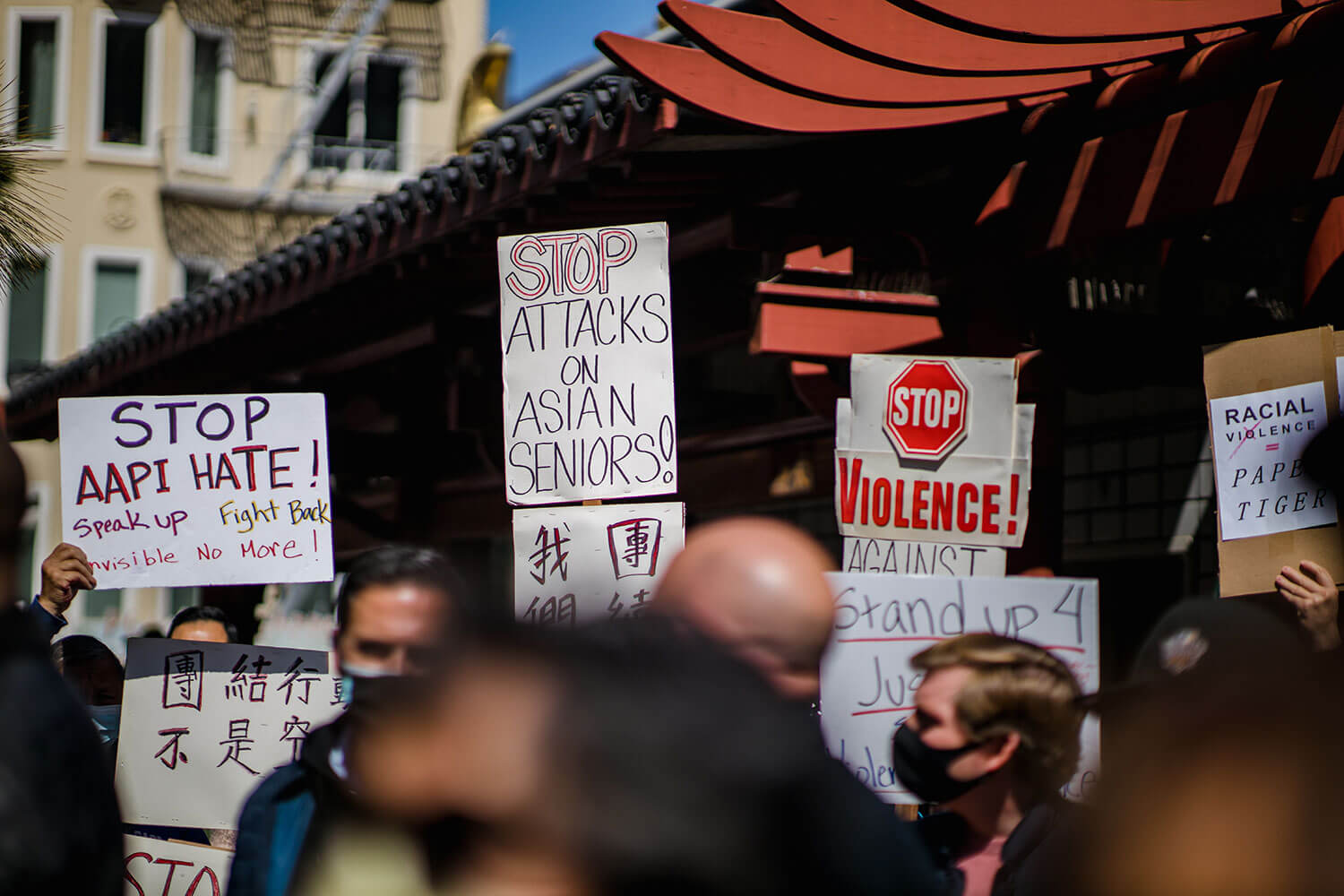 "Signs that say ""Stop AAPI Hate"" and ""Stop Attacks on Asian Seniors"" at a recent protest"
