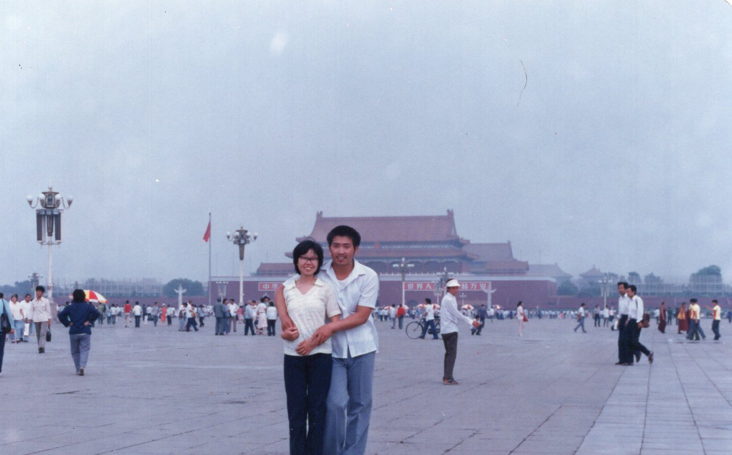 The writer's parents standing in Tiananmen Square in Beijing in the 80s.