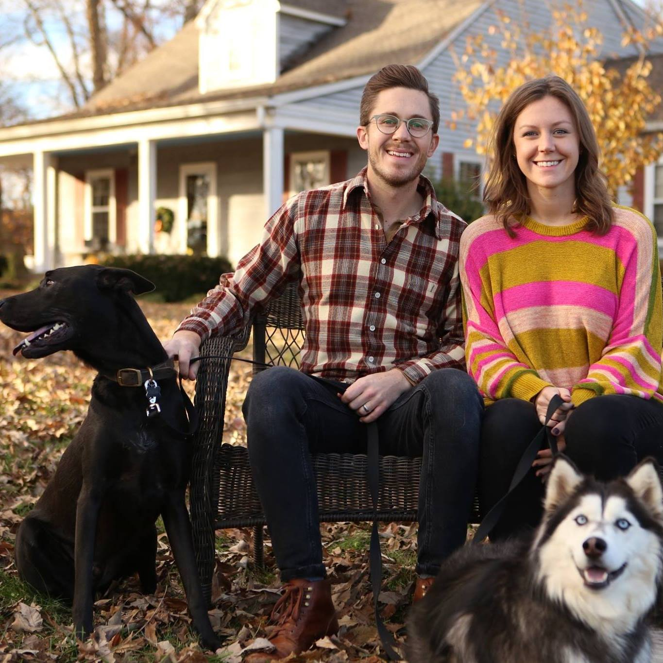 Gracie sits with her husband and her dogs