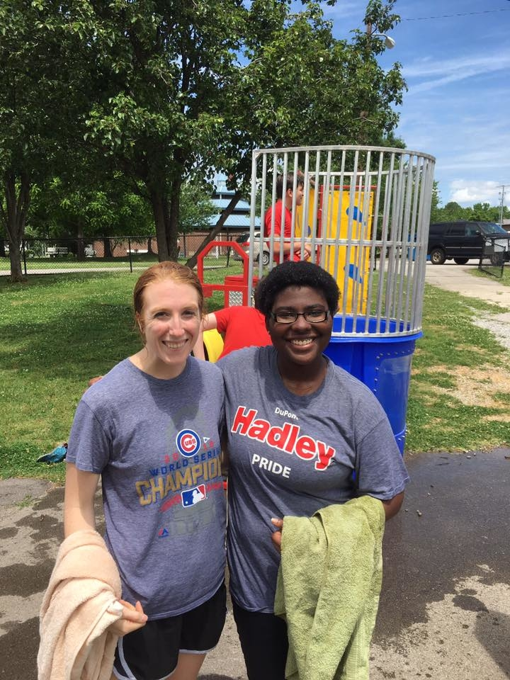 Hannah and another teacher posing with towels after participating in a dunk tank