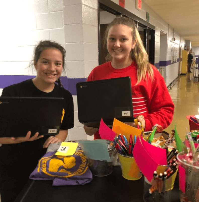 Two students shown with laptops running a School PBIS store