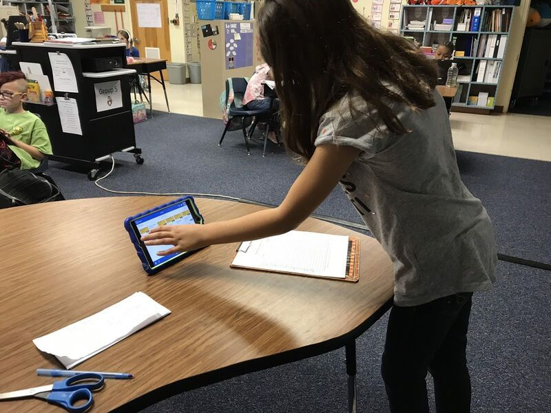 Student using LiveSchool to choose a PBIS reward