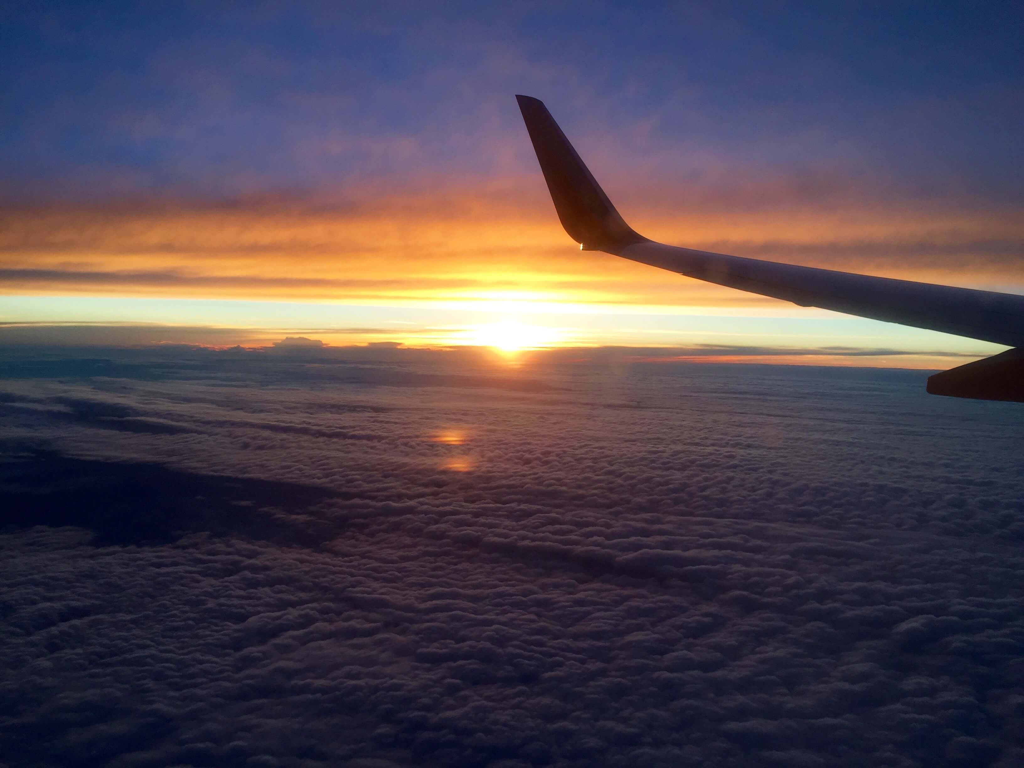 blog-top-5-adventures-before-25-sunset-on-a-plane