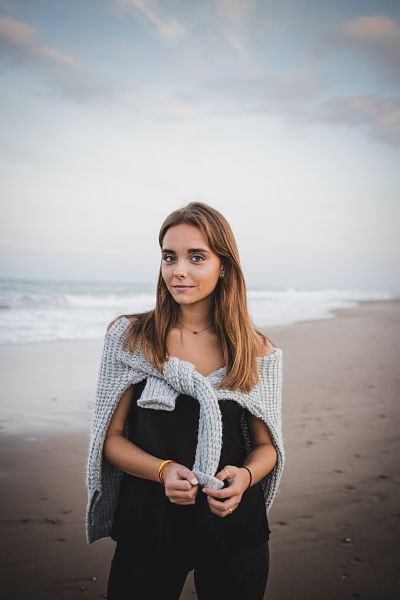 woman-on-beach-with-cardigan
