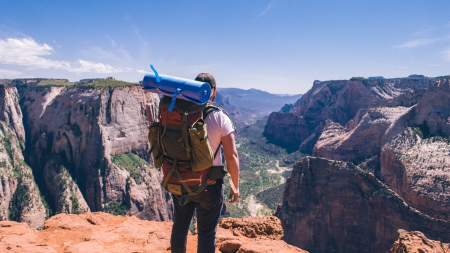 Backpacker overlooking Zion Canyon