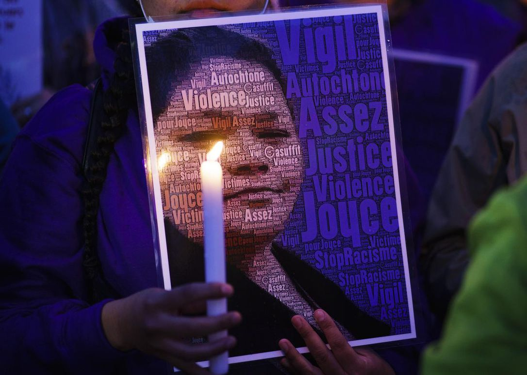 A woman attends a vigil in front of the hospital where Joyce Echaquan died in Joliette, Que. on Sept. 29. A nurse was fired after Echaquan, an Indigenous woman, who was dying Monday night in hospital was subjected to degrading remarks.