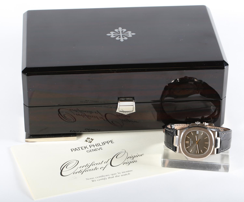 Patek Philippe 18K White Gold Nautilus Wristwatch with Original Certificate and Box, Ca. 2009.