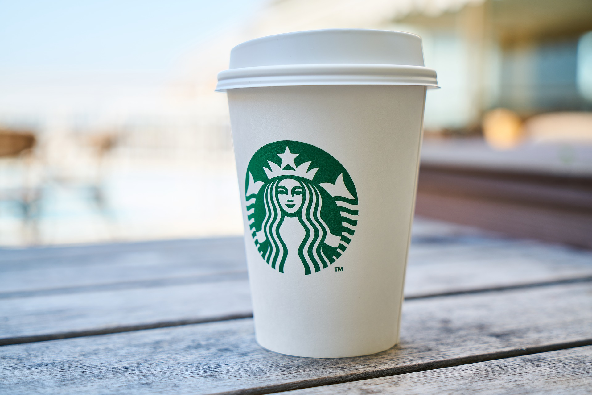 A Starbucks coffee cup and lid