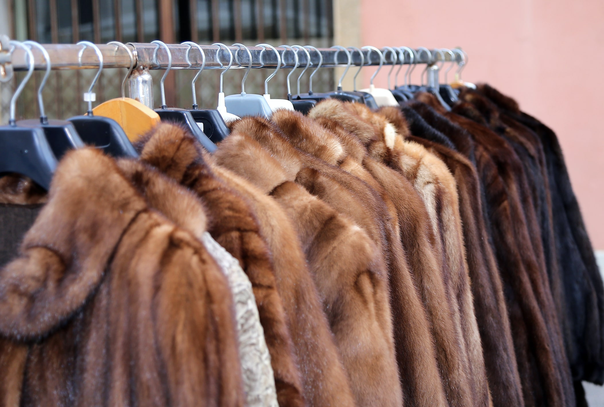 A rail of fur coats