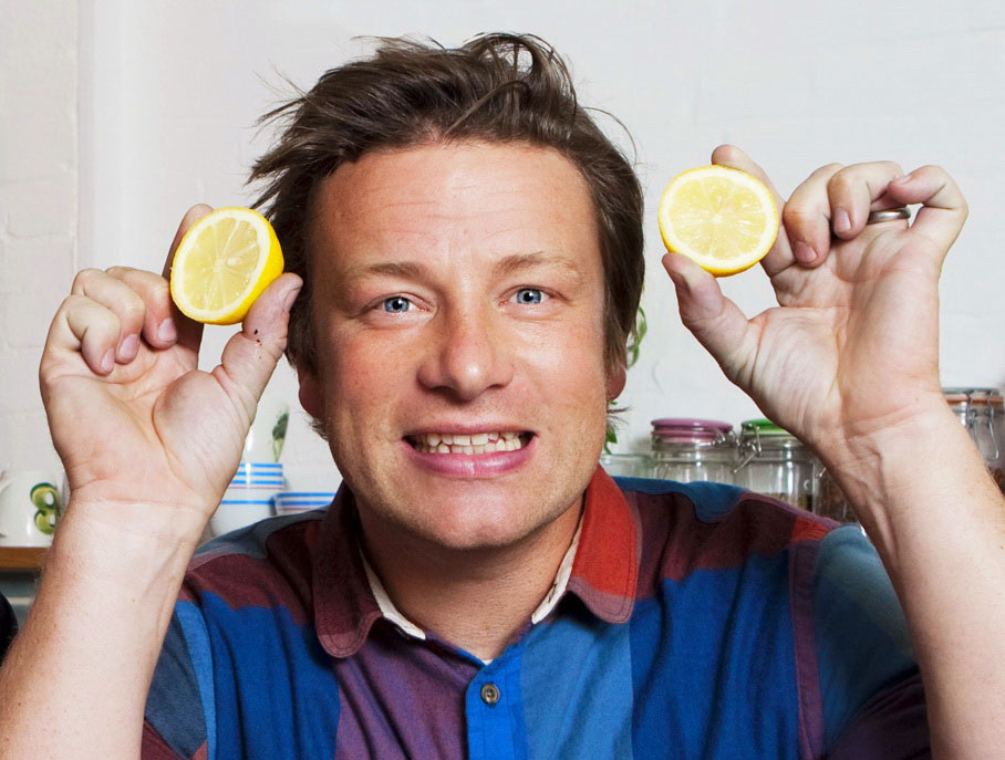 Chef Jamie Oliver holds some lemons