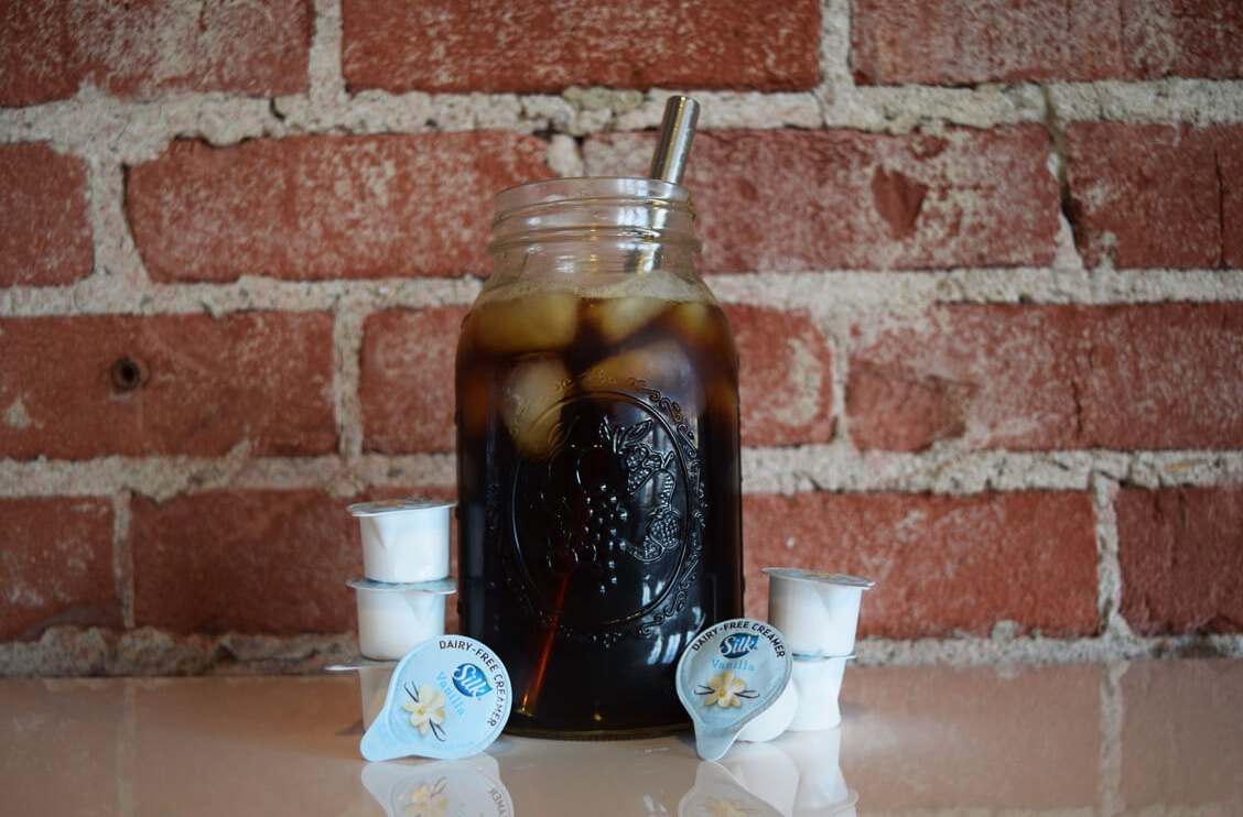Iced coffee with dairy-free creamer singles by PETA