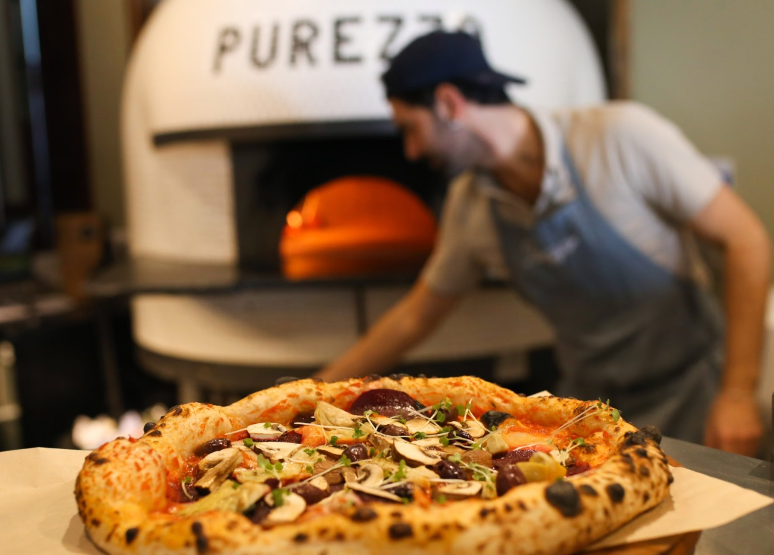 Making pizza at vegan pizzeria Purezza