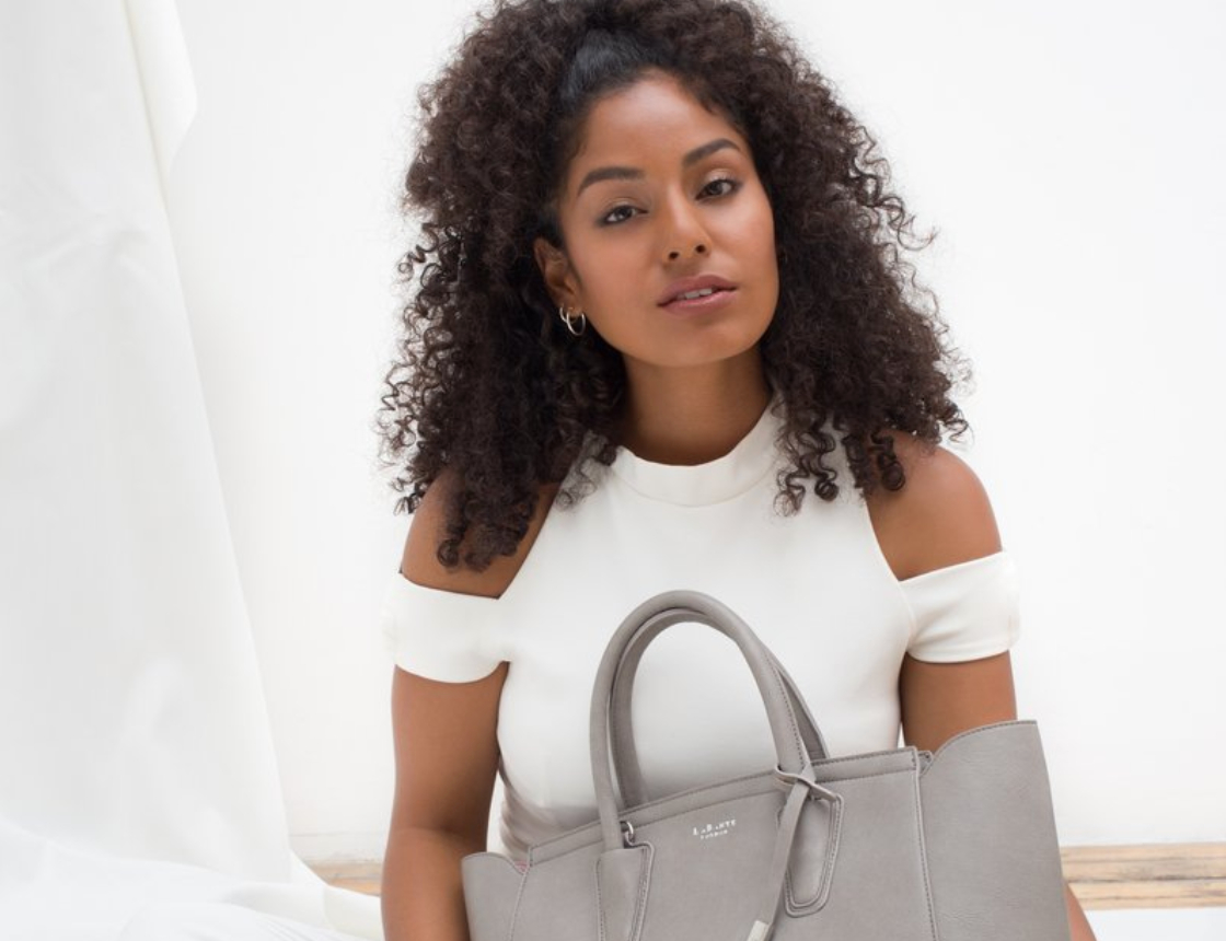 A woman with a grey LaBante handbag
