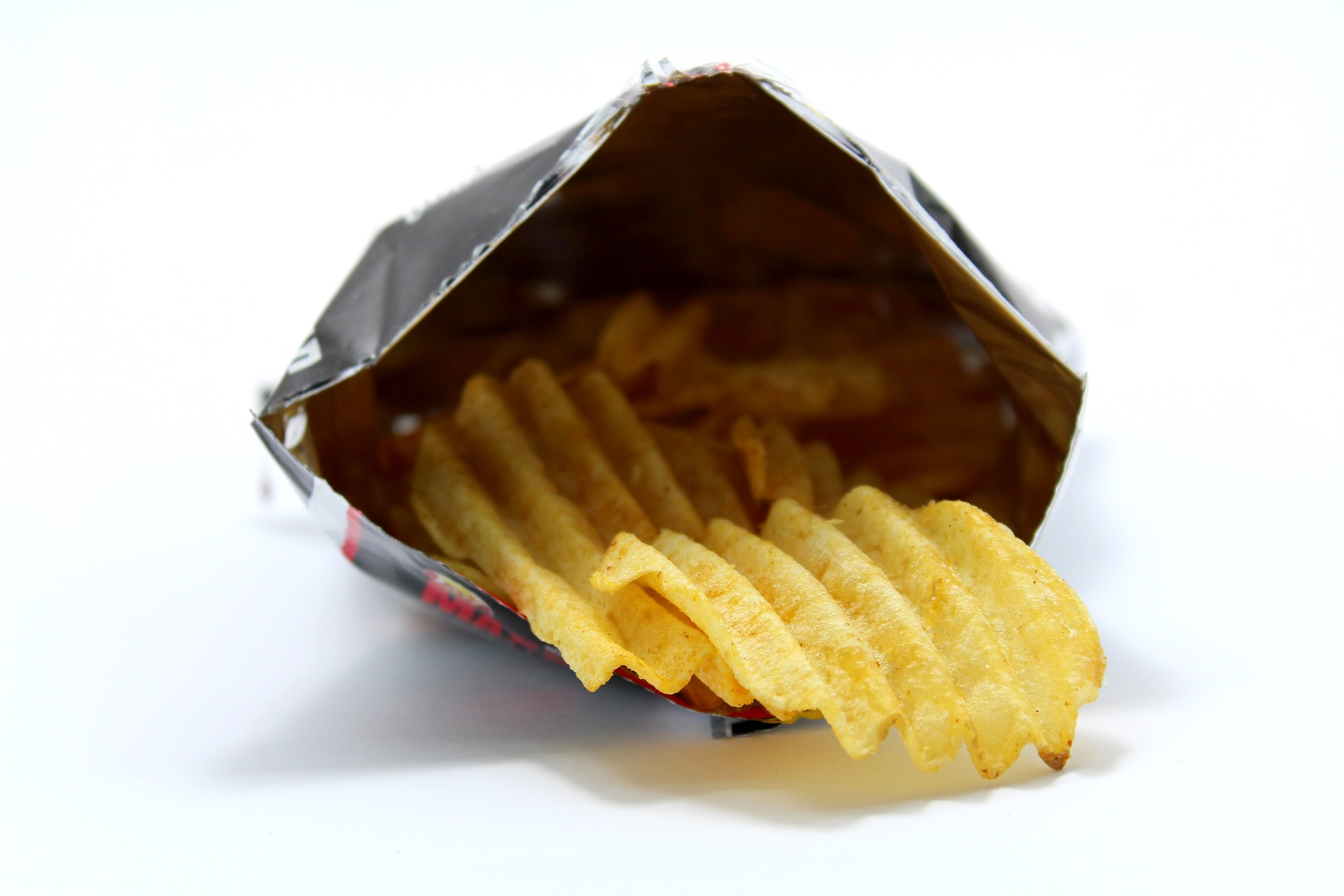 An open bag of crinkle-cut crisps