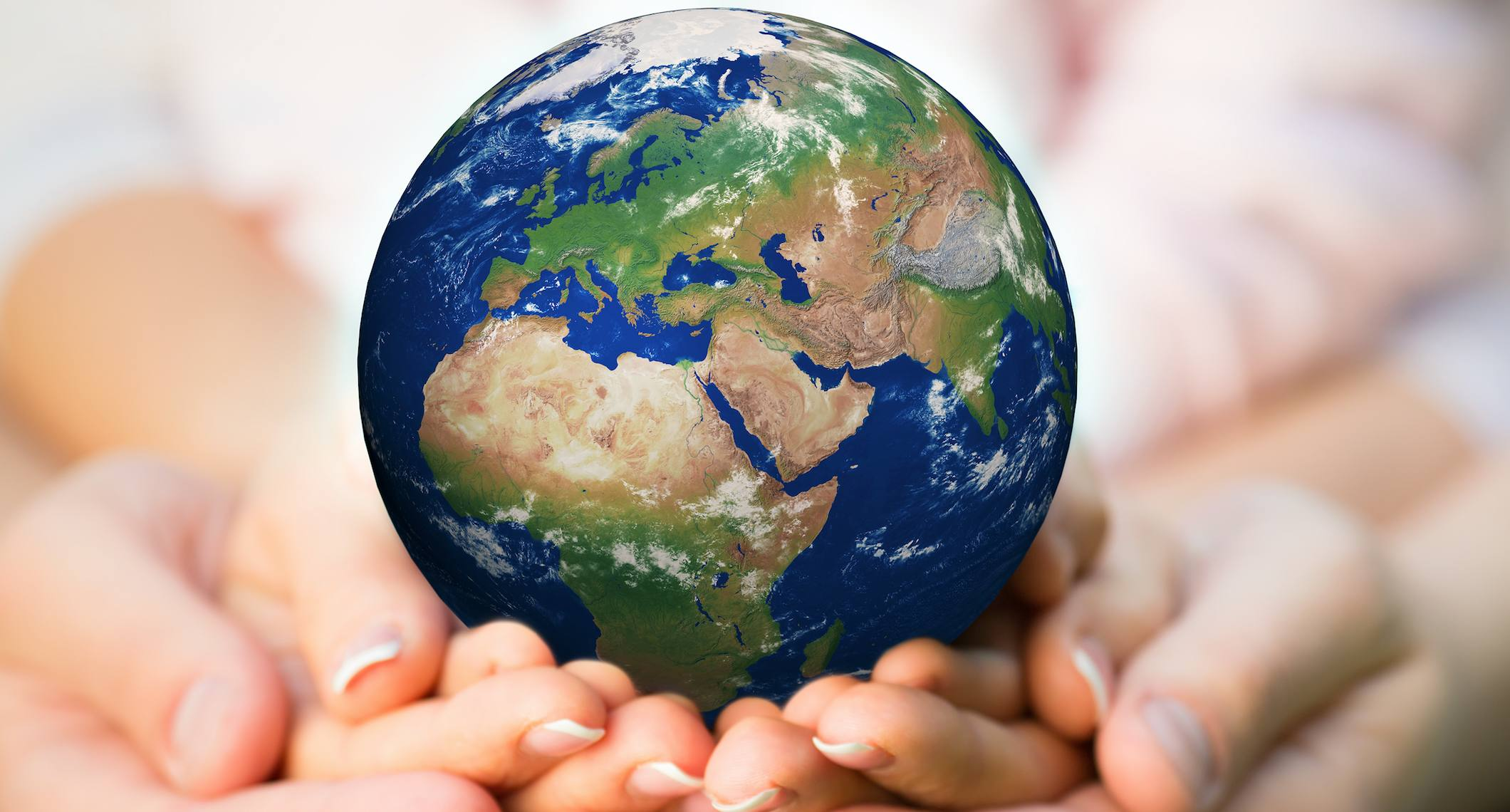Planet Earth in peoples' hands
