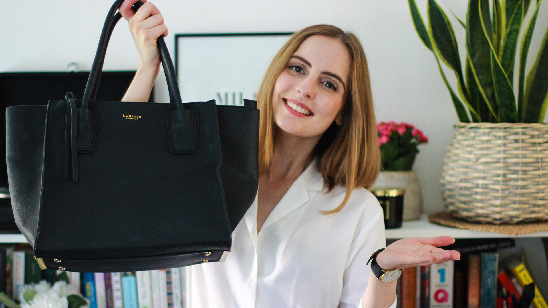 Marta Canga holds a vegan LaBante London handbag