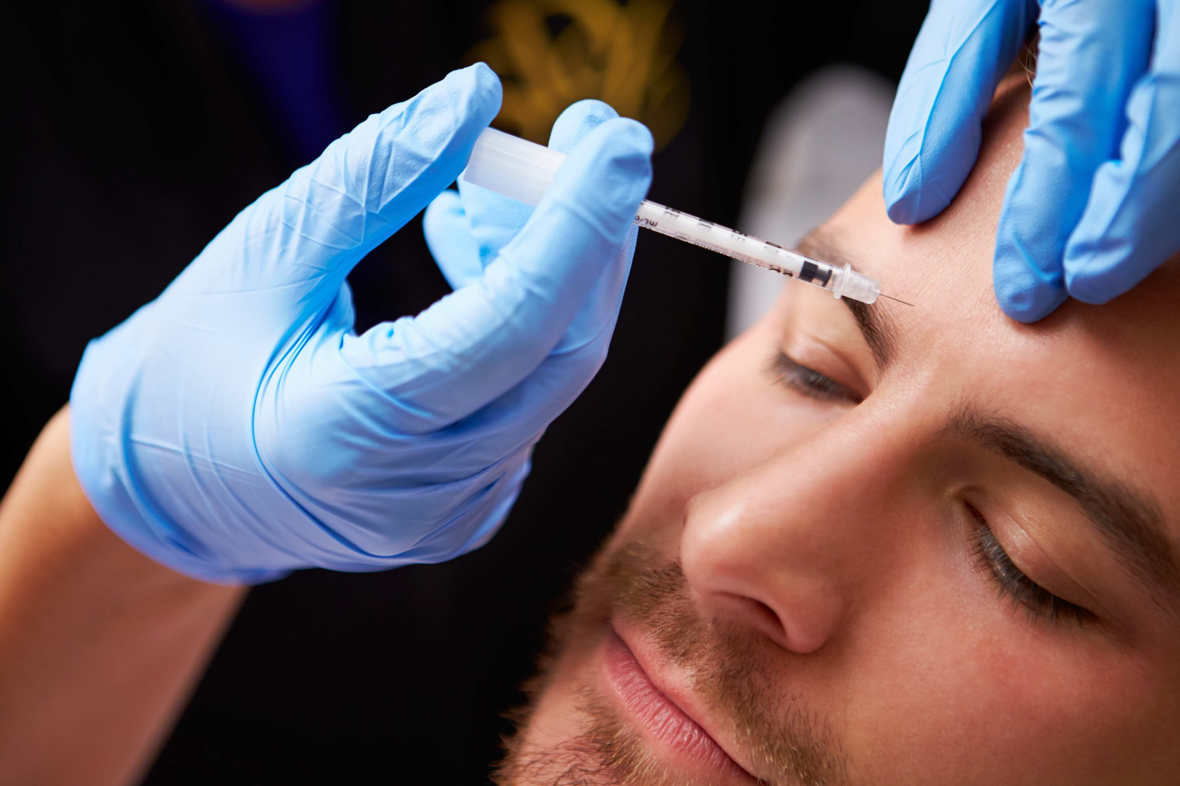 A man getting Botox injections