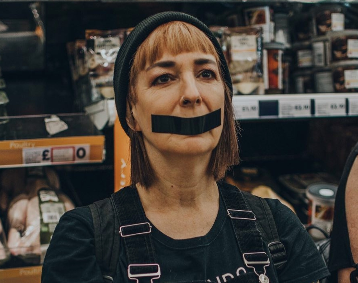 Vegan activist from DxE protests the exploitation of animals in Tesco