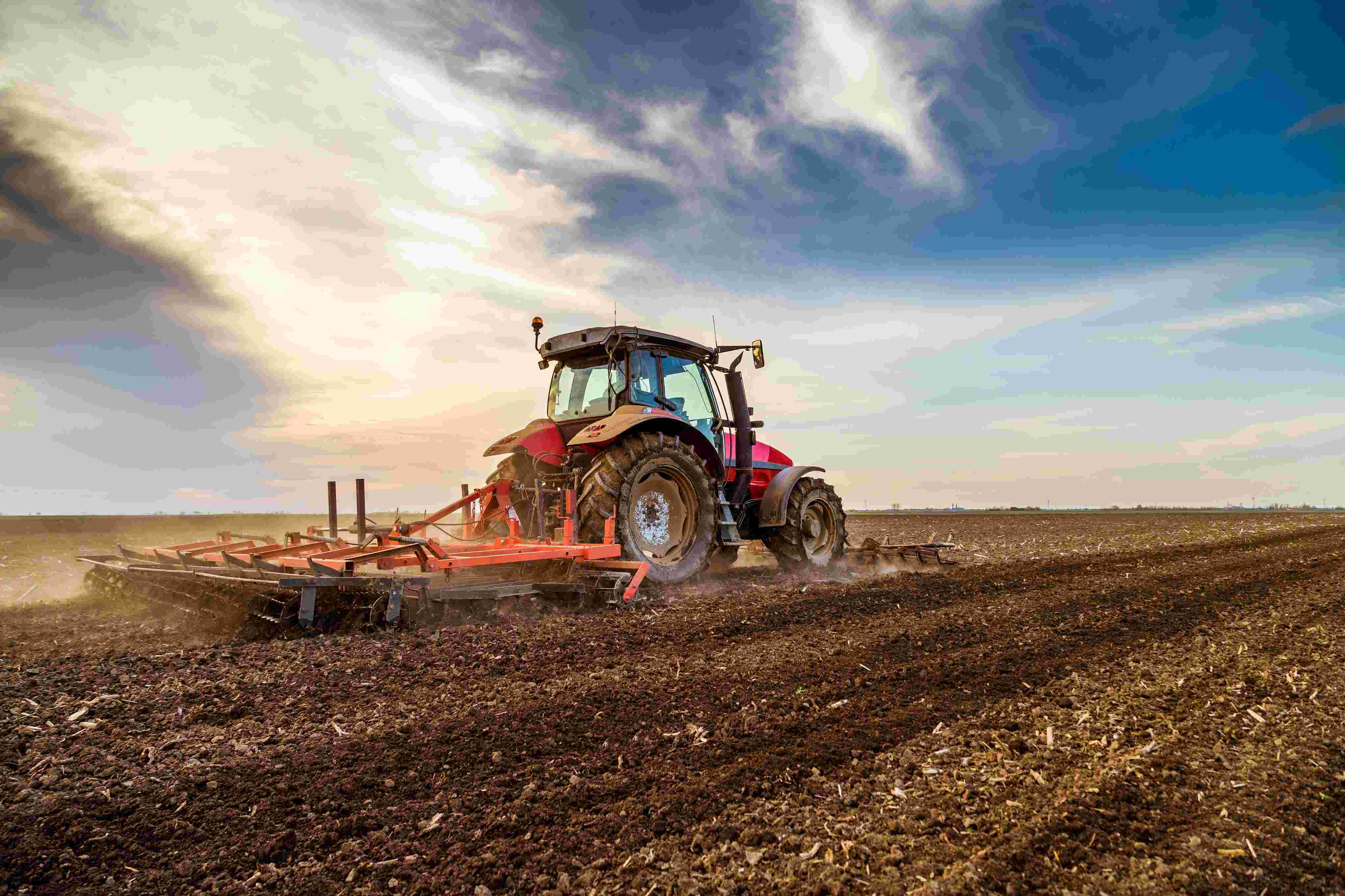 A tractor ploughs a field