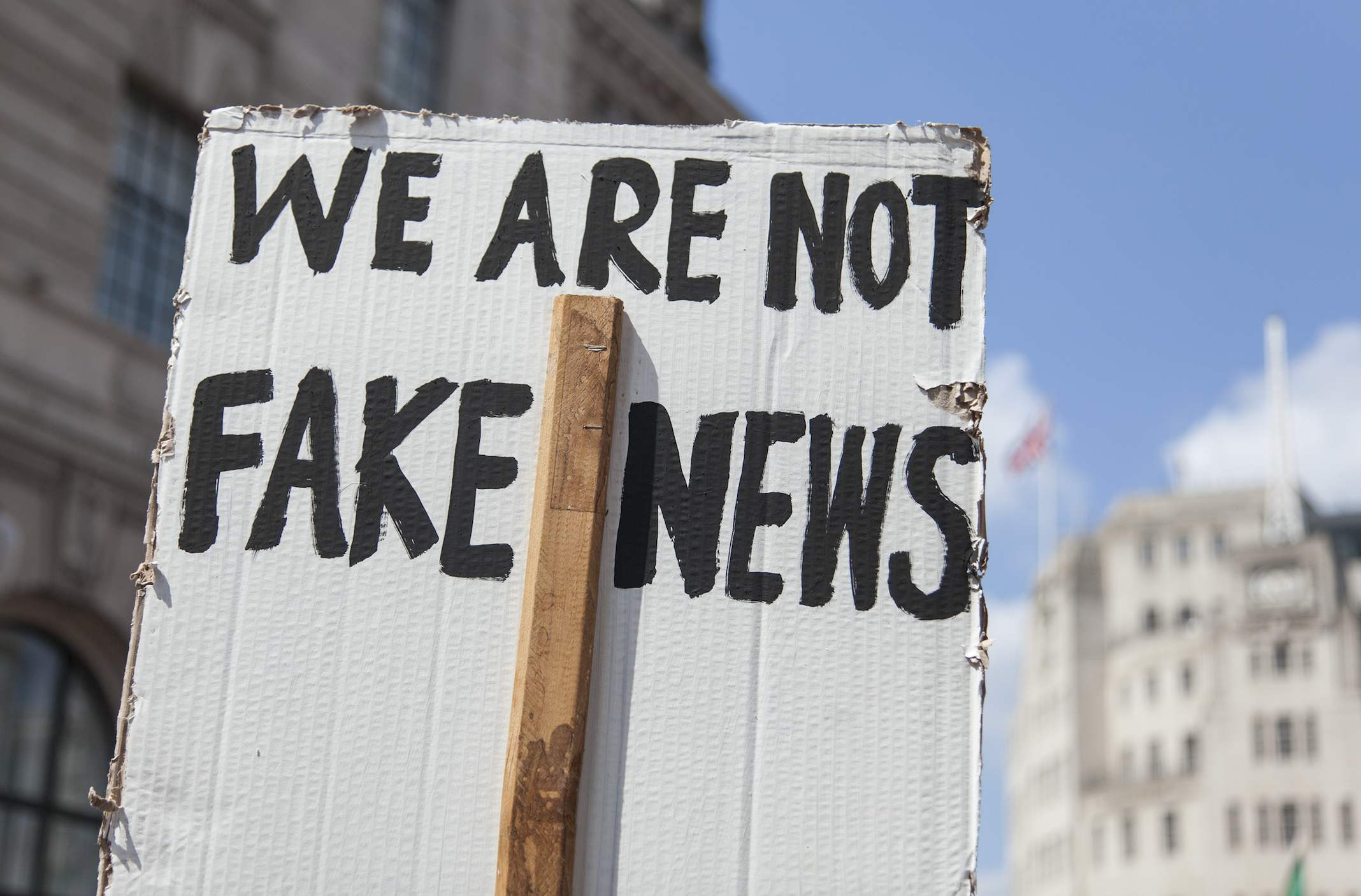 Placard saying 'we are not fake news'