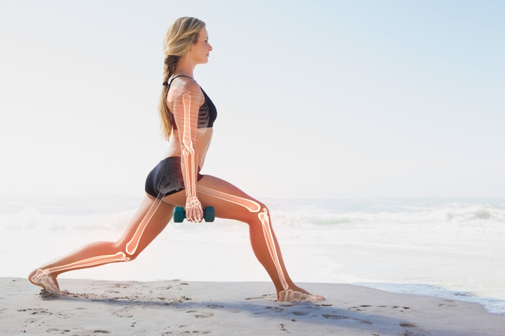 Exercising woman on a beach