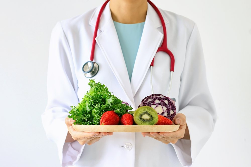 Doctor holding tray of vegetables