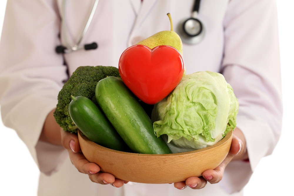 Doctor hold bowl of fruit and vegetables