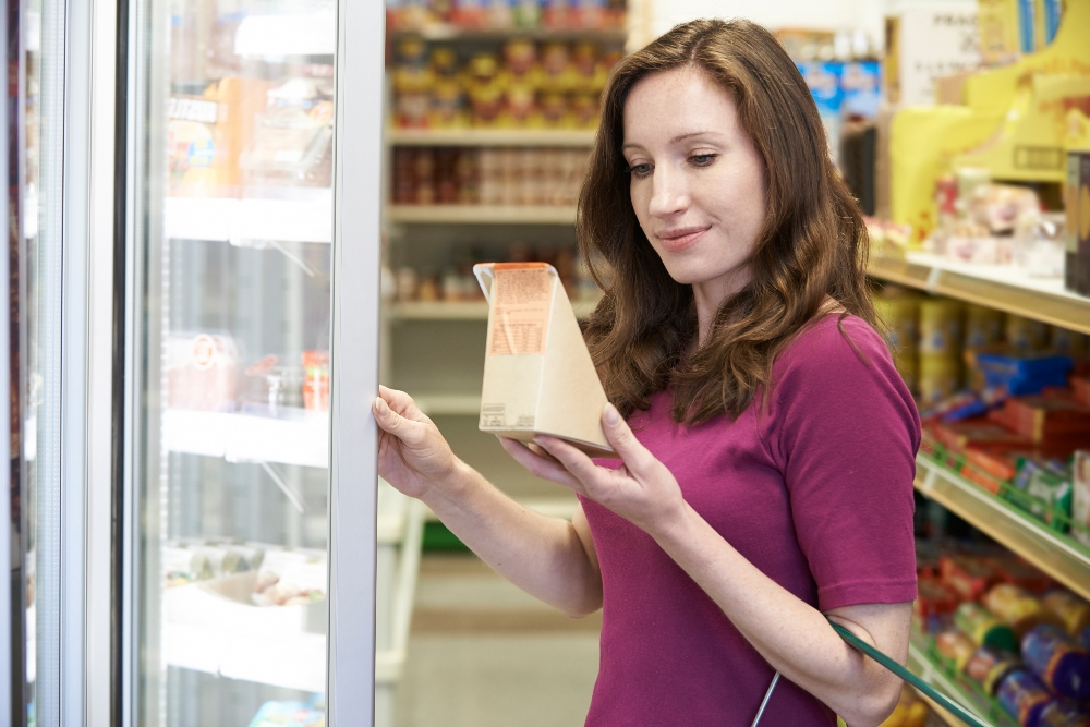 Woman reading food label
