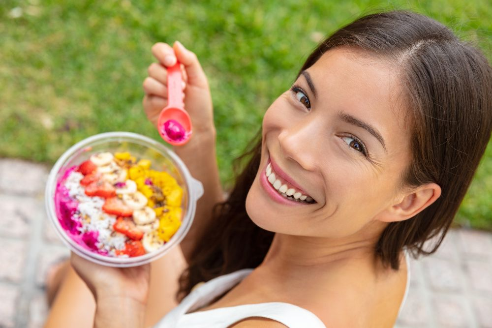 Woman eating smoothie bowl