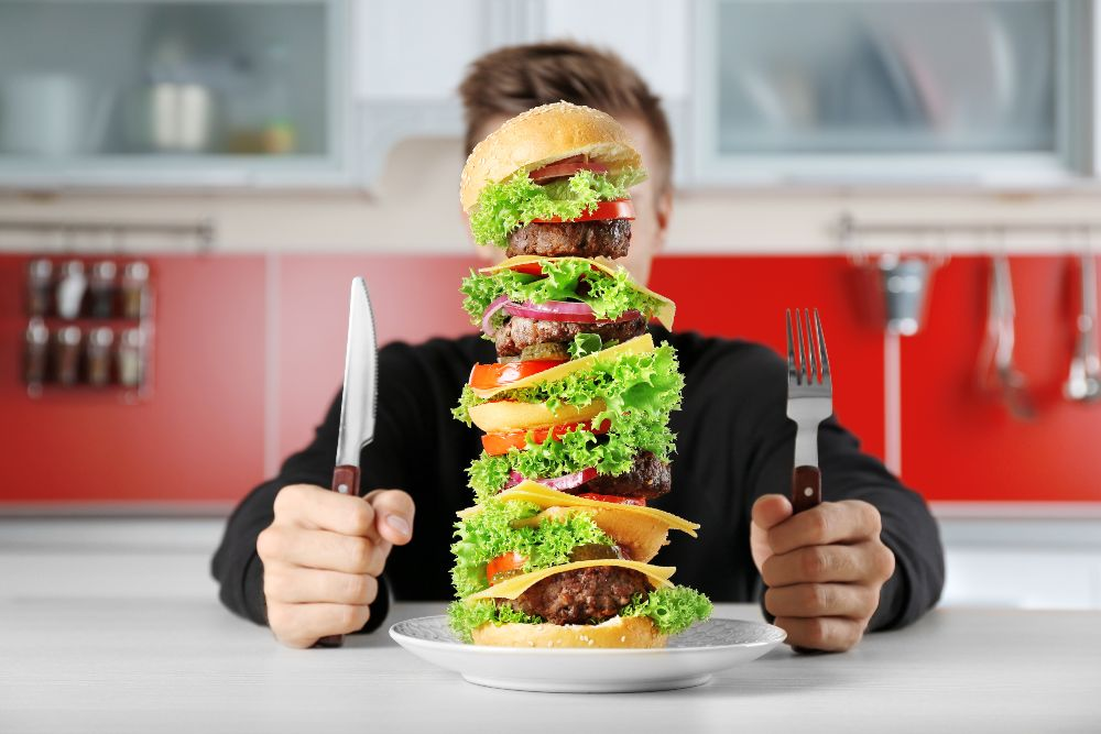Man eating huge burger