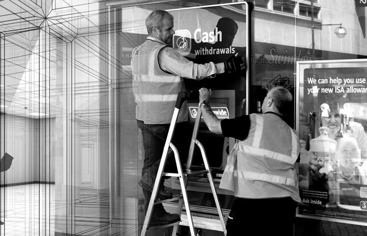 An image of two people installing a bank ATM machine, used to represent Cennox