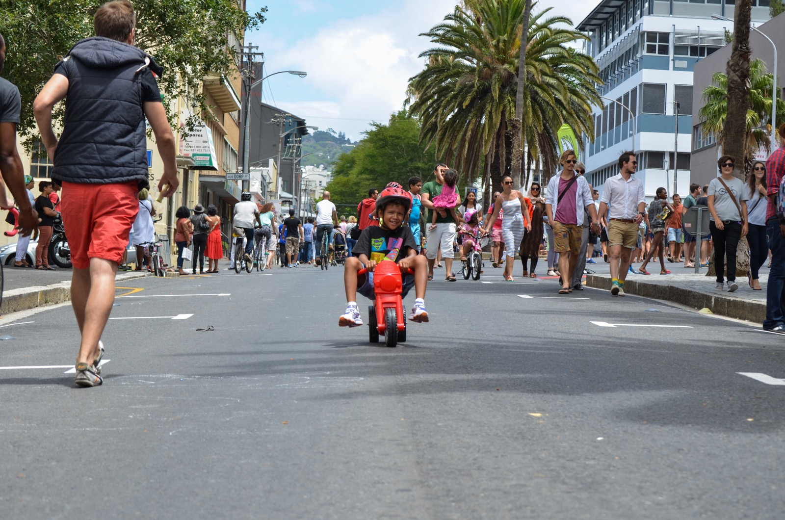 Kid biking down car-free Bree Street in Cape Town