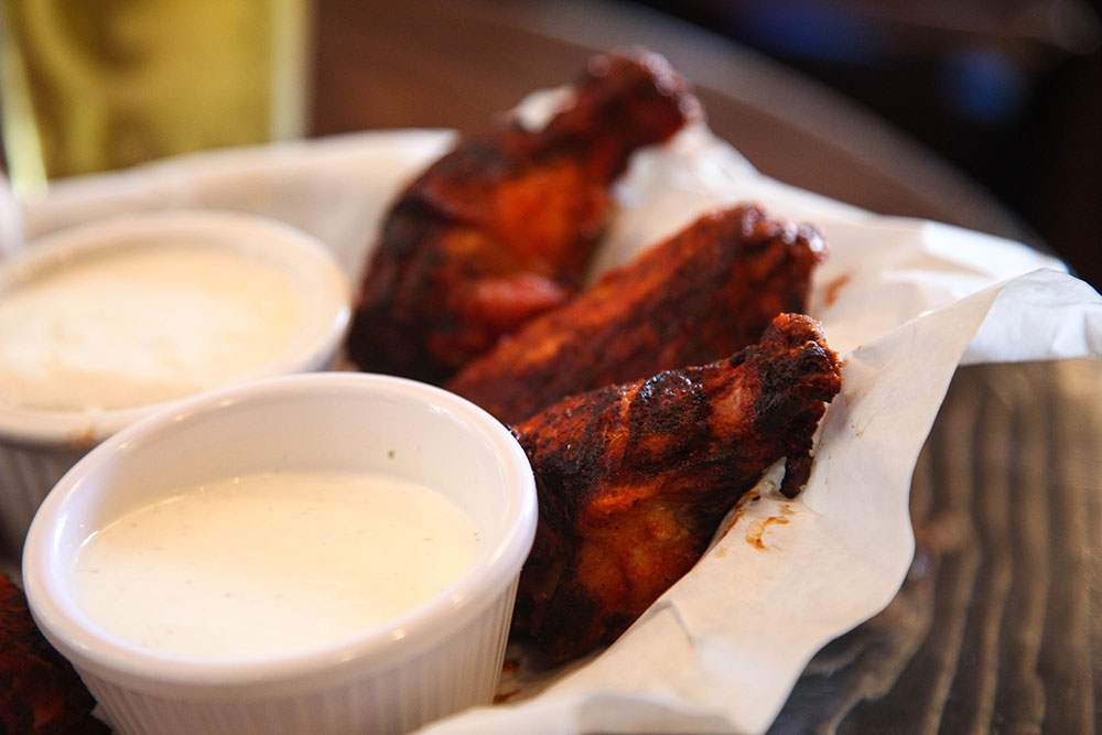 Albert G's smoked chicken wings, with what they call Roughneck sauce, really have a flavorful taste and a little kick to them. (Photo: Marc Rains)