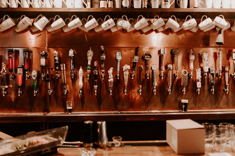 The bar with 72 taps lets you know you have all the time in the world to explore McNellie's beer menu. (Photo: Sarah Eliza Roberts)