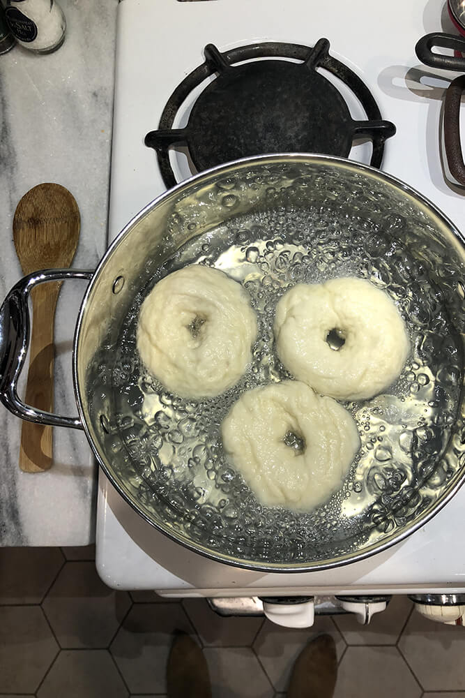 After rolling out the bagels, the next step was to boil them in a large stockpot for two minutes on each side (the longer the boil, the chewier they will be).