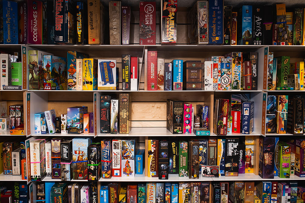Customers can select from an extensive board game library that contains over 700 titles. (Photo: Sarah Eliza Roberts)