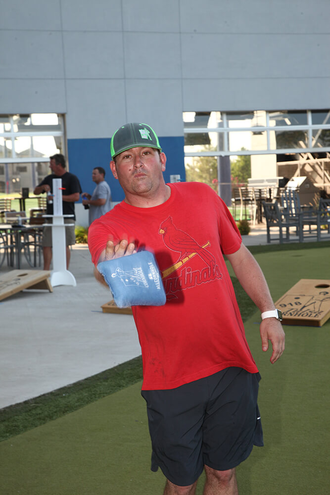 While the local cornhole scene in Tulsa is gradually increasing in popularity, Jason Strickland, a U.S. Air Force veteran, points out he is not ready to quit his day job. (Photo: Marc Rains)