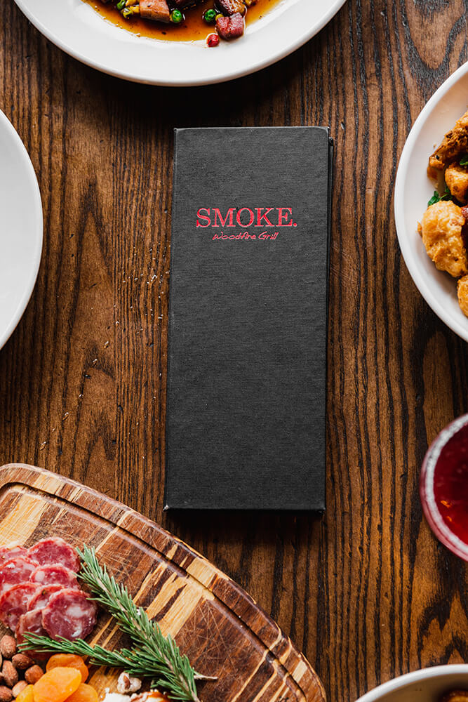 SMOKE. takes its name from the woodfire grill and the wood smoker used to make their bacon. That woody, smoky flavor kisses all the proteins during their time over theflame. (Photo: Sarah Eliza Roberts)