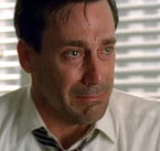 A close up of Don Draper crying.