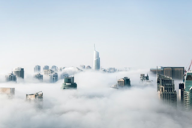 image of buildings in clouds