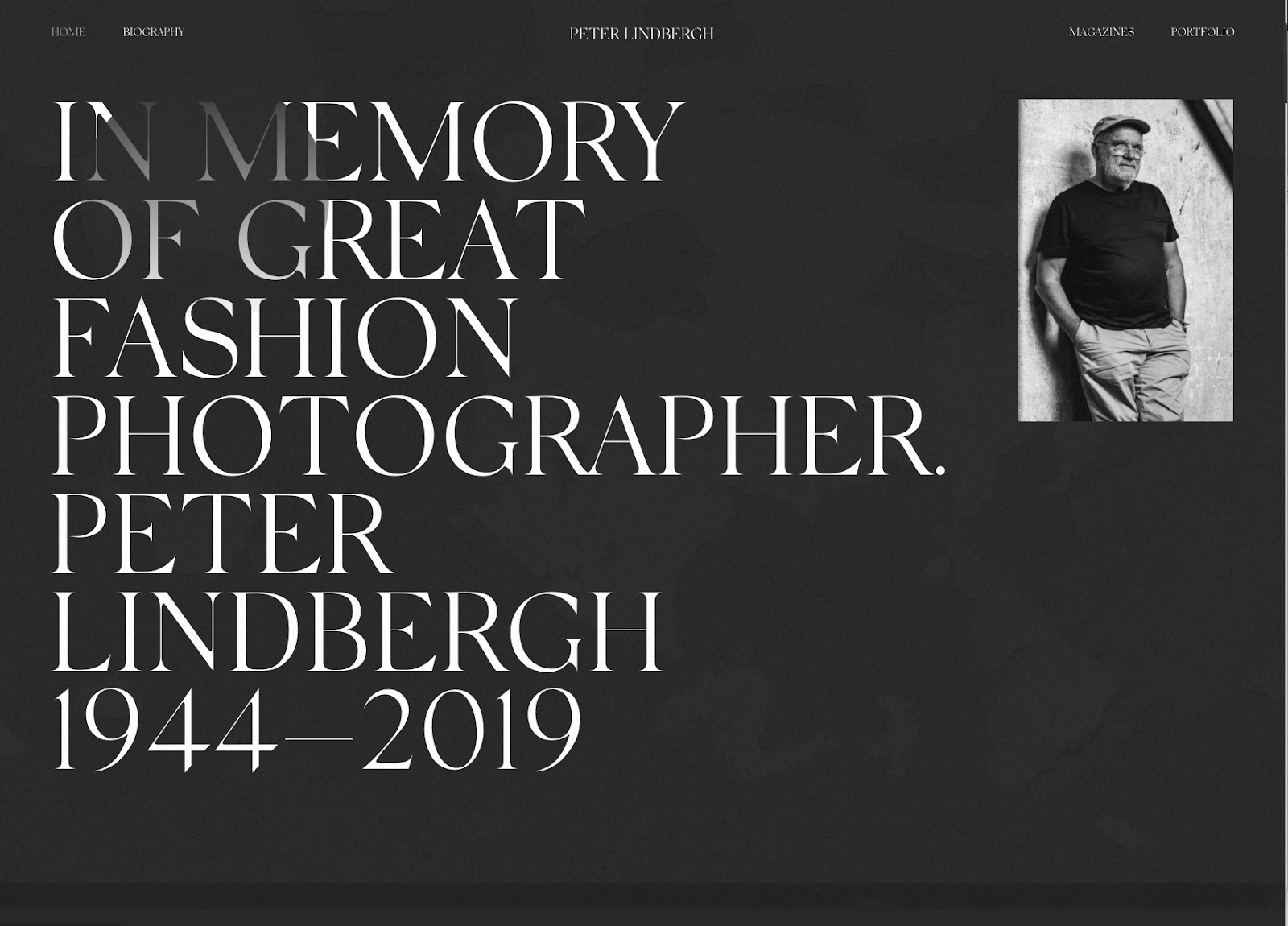 A beautiful tribute to late fashion photographer Peter Lindberg uses dark mode and a simple black and white photo of the photographer.