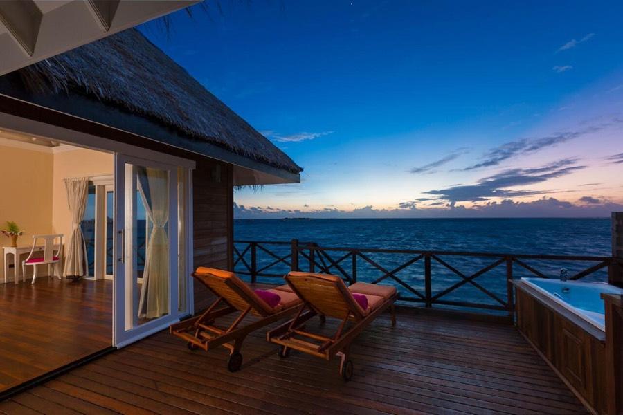 Resort Maldive Sun Aqua Vilu Reef sunset reef villa