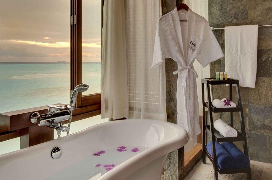 Resort Maldive Olhuveli Beach & Spa sunset jacuzzi water villa
