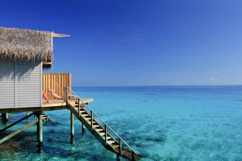 Centara Ras Fushi Resort Maldive deluxe sunset water villa