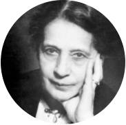 A black and white portrait of an older Lise Meitner.