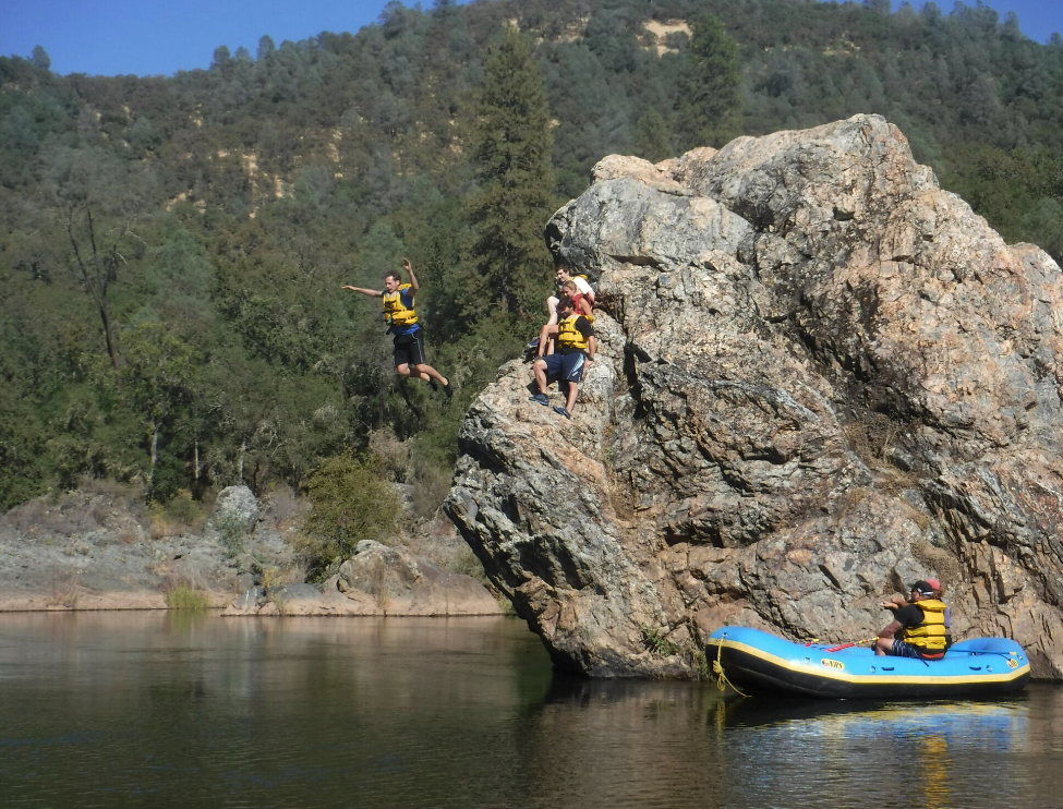 CloudApp team jumping off rocks