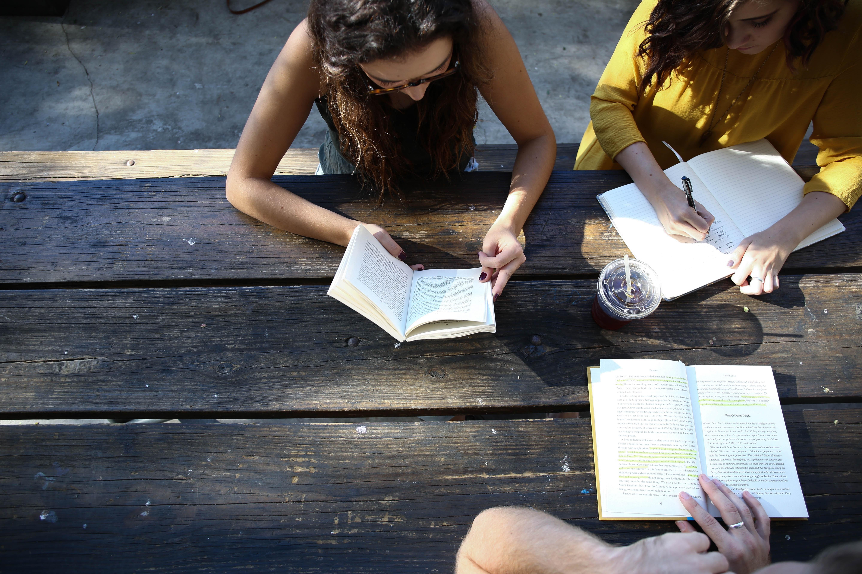 3 Girls reading a book