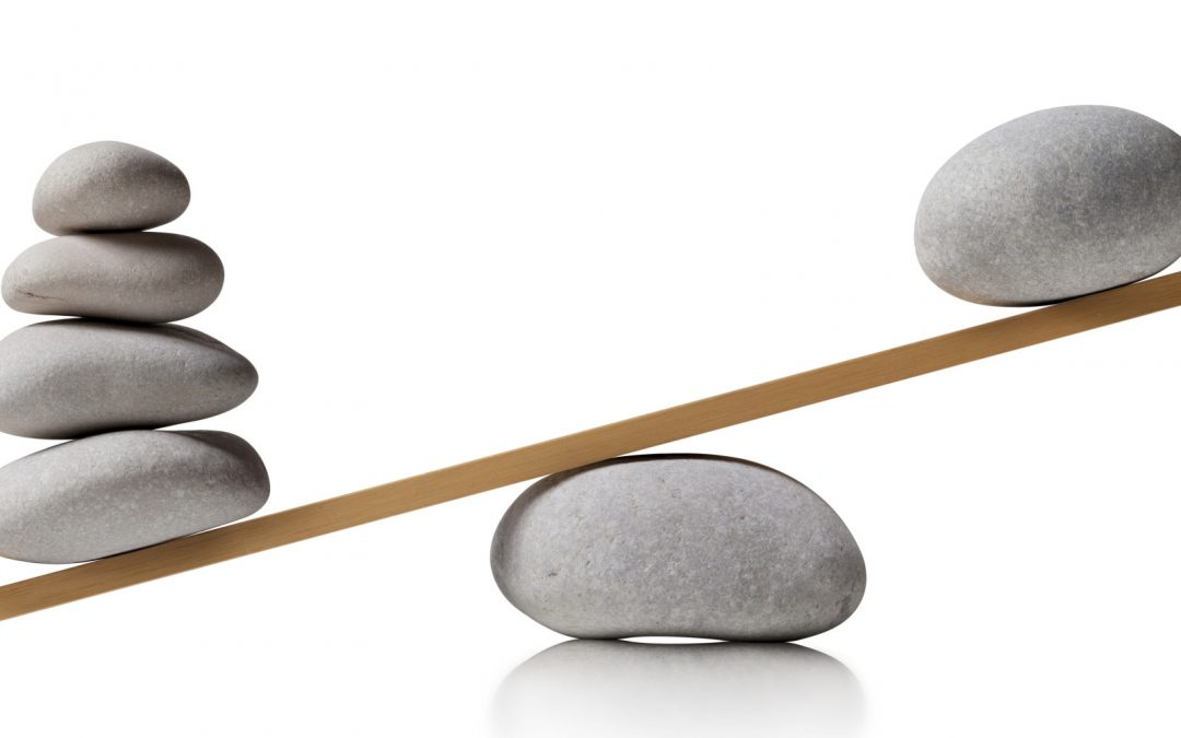 Rocks balancing on a board