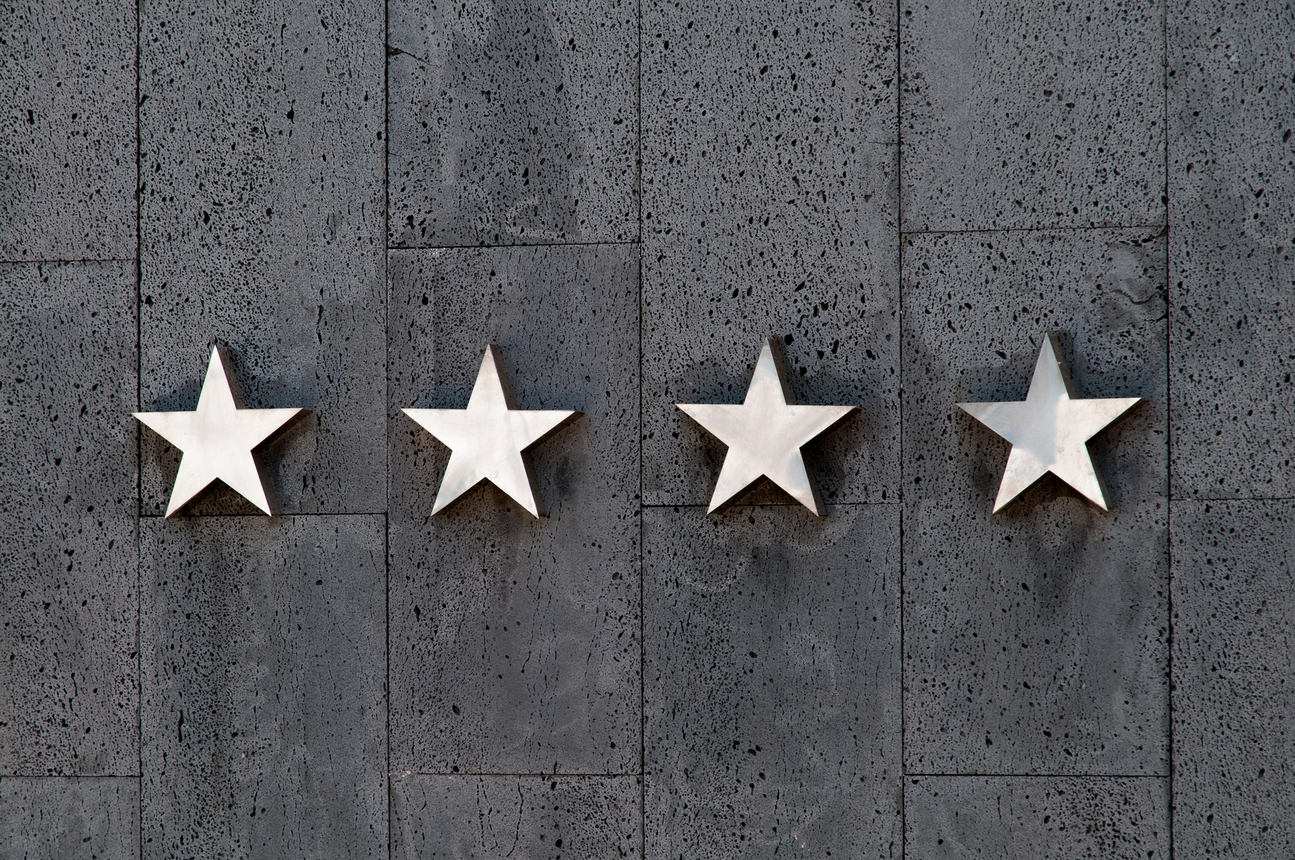 Wall with four stars